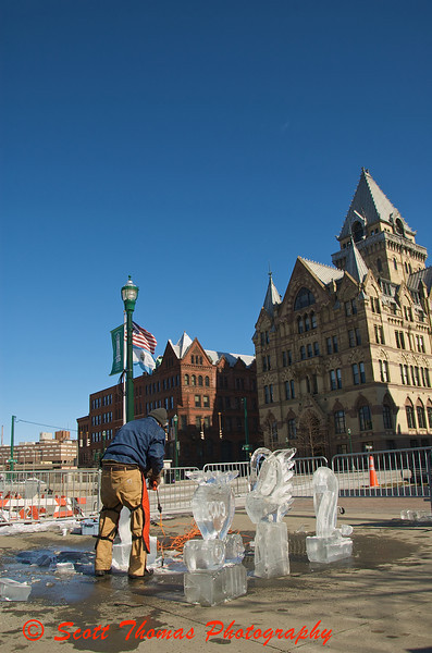 Ice carver, Adam Vural, uses 300 pound blocks of ice to create sculptures in Clinton Square during Syracuses Winterfest.