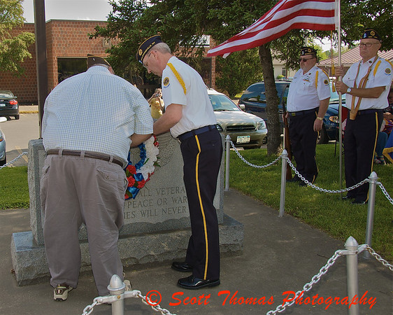 Honoring those who gave their life for our freedom by placing a wreath at the Veteran's Monument before the start of the Baldwinsville (New York) Memorial Day Parade on Saturday, May 30, 2009.