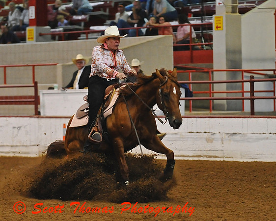Reining horse digs into the dirt at the CNY Reining Horse Association Show in Syracuse, New York.
