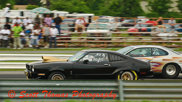 Pro Stock Class cars flying down the 1/4 mile at ESTA Safety Park Dragstrip.
