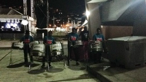 A local steel pan group plays outside the entrance to the stadium.