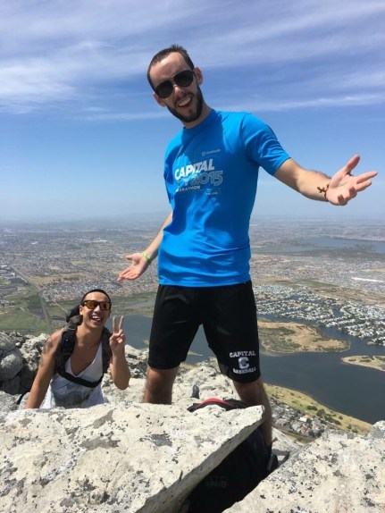 Don Nguyen and I celebrate reaching the top of a mountain overlooking Muizenberg on our first day in South Africa.
