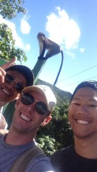 Don Nguyen, myself, and Kevin Wang in front of one of Grand Etang's Mona monkeys.