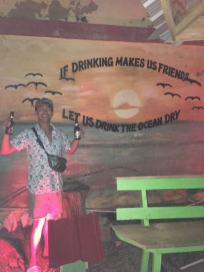 Don Nguyen poses in front of the mural at BG's Bar in Grenville.
