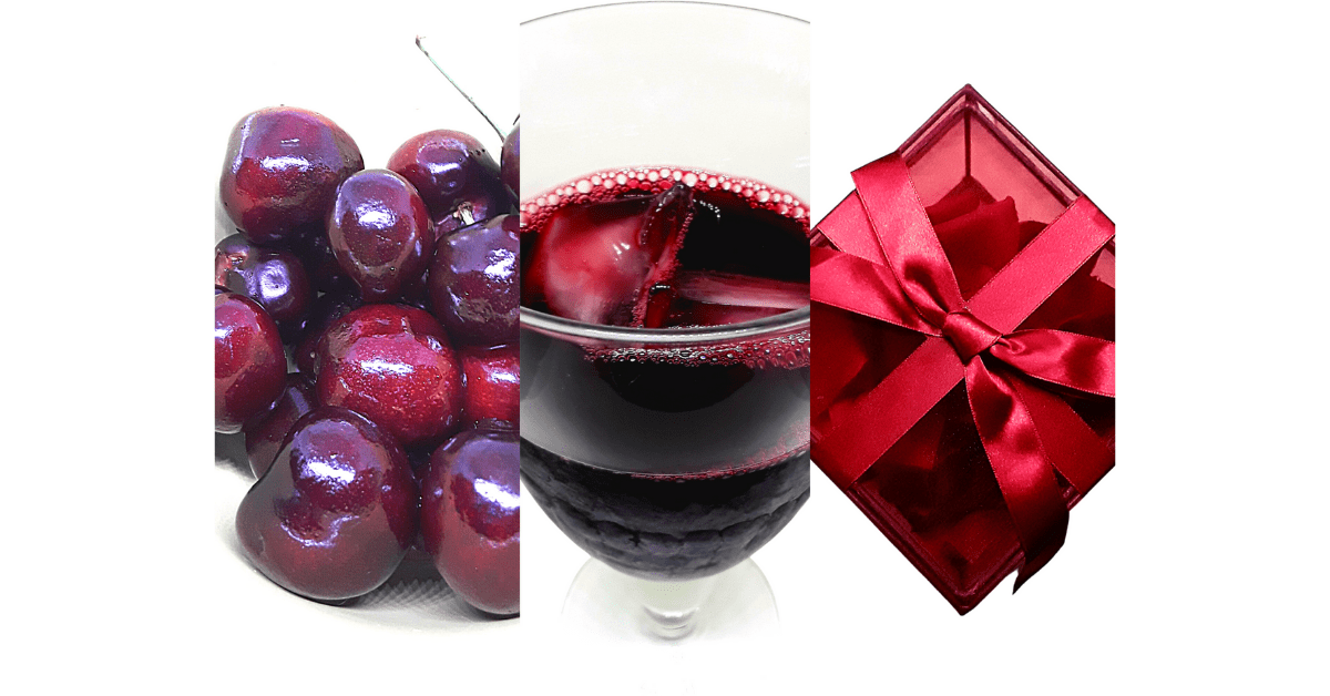 Glimpse of fresh cherries, cherry juice, and red gift