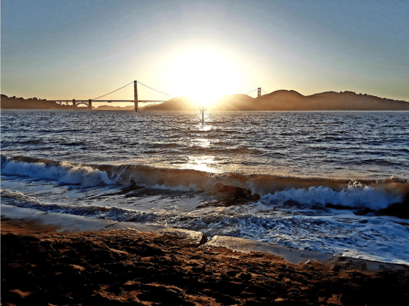 Sunshine, bridge, hills, ocean, sand