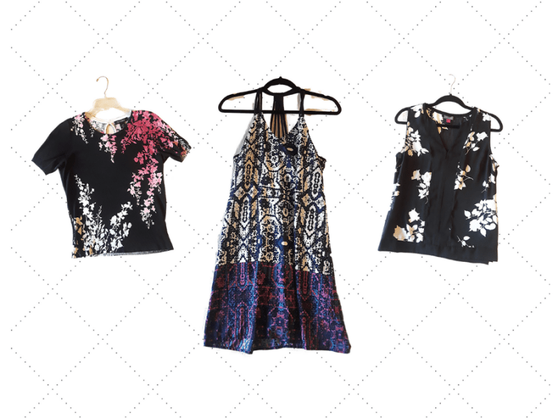 Thrift shop clothing: black, white, and hot pink short-sleeved sweater, navy blue, purple, and white strappy summer dress, and black and white floral v-neck tank top