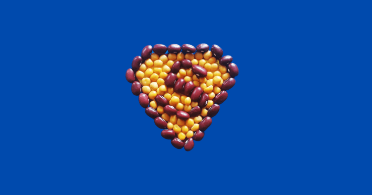 Are Beans Superfoods Image with red beans and yellow peas arranged in a superman configuration with blue background