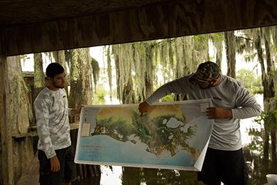 Staffers René Guilbeaux and Derek Breaux explain the area's ecosystem.