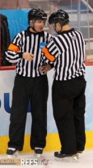 Referees Ryan Hersey and Geoff Miller