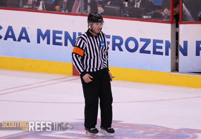 Referee Geoff Miller at the NCAA Frozen Four National Championship Game - April 14, 2014