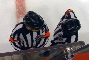 Referees discussing the play on the ice; now