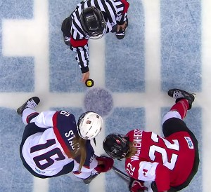 Referee Joy Johnston drops the puck at the 2014 Women's Olympic Gold Medal Game between Canada and the US