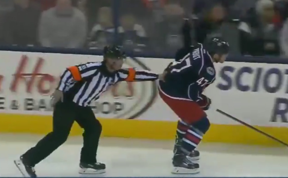 Ref Helps Jackets' Prout to Bench After Puck to Groin
