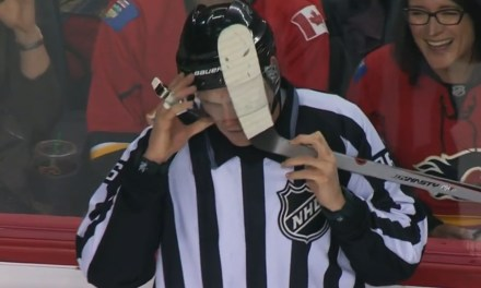Linesman David Brisebois Gets Stick Caught In Visor