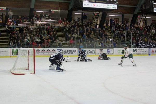 Referee Kevin Keenan goes down as Vermont's Dan Senkbeil breaks in alone