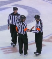 Referees Rob Martell and Francis Charron discuss the goal