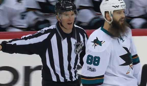 Linesman Steve Barton Makes Sharks' Burns Retrieve Puck