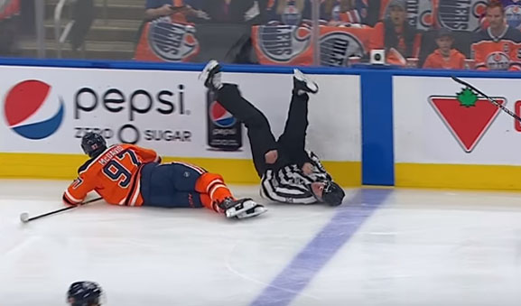 Linesman Steve Barton Injured in Collision with Oilers' McDavid
