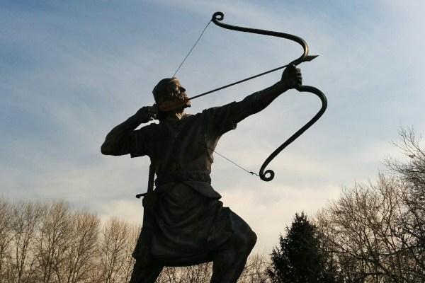 Archery statue in silhouette
