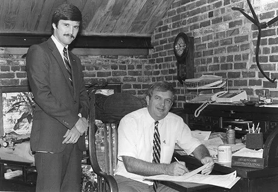 Bill Collins signing the contract for the purchase of his offset press.