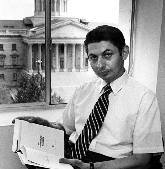 1970: Bass upon the publication of his book, The Orangeburg Massacre, with the South Carolina State House in the background. (Photo by Bill Barley).