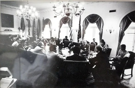 Kinney attends a meeting with President Jimmy Carter.