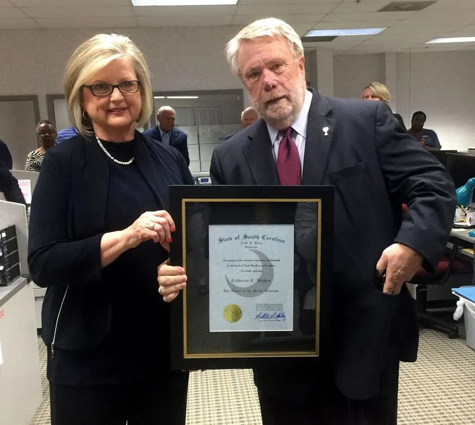 Cathy Hughes was presented with the S.C. Order of the Silver Crescent in 2017 by Secretary of Commerce Bobby Hitt at a Chamber event held at The T&D. Cathy was recognized for her outstanding achievements and community contributions.