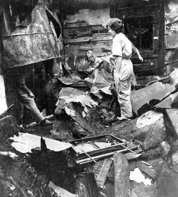 Hughes, (left) and Carole Steverson go through damages at the Times and Democrat after the fire of 1972. Photo credit: The Times and Democrat.