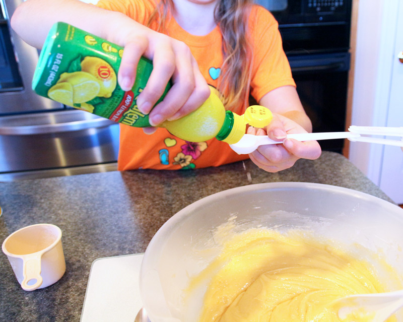 Megan adding lemon juice.