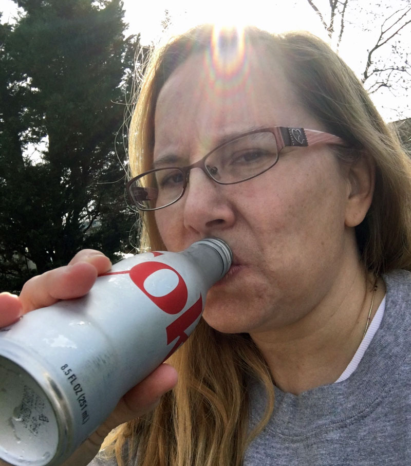 Michele drinking ice-cold Diet Coke at #RetweetsofLove sculpture. #AD