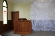 Drapes against the wall and ceiling