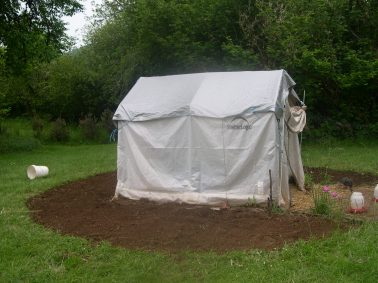 Finished working up the dirt around our chicks tent. I will be planting my tobacco seedlings around the tent. I found out you can't grow Tobacco near produce. For some reason produce plants don't grow well when planted near tobacco. I keep the chicks in this tent until they are fully feathered out.