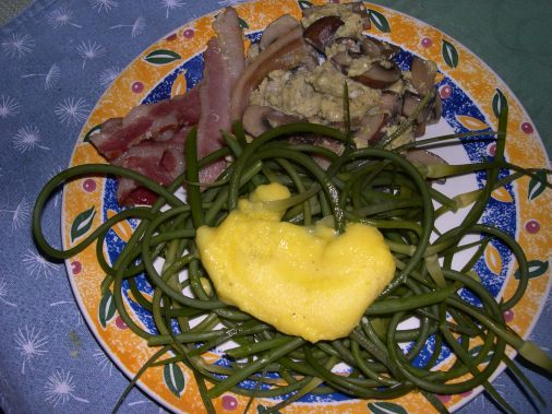 My Hollandaise sauce is a little thick. I forgot to steam the scapes whilst cooking the sauce. Usually it isn't so thick. The bright yellow color is from organic raw milk butter and backyard organic eggs. Organic food has intense flavors and colors!