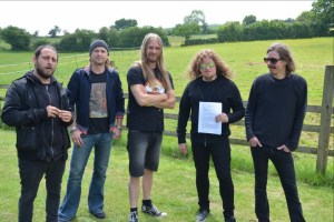 OPETH holding their signed contract with Nuclear Blast Entertainment. Photo credit: Ben Lodwick
