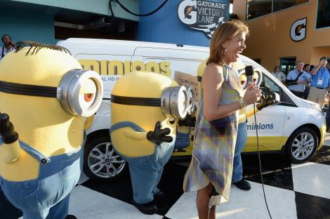 "HOMESTEAD, FL - NOVEMBER 22: ""Today Show host"" and grand marshal Hoda Kotb starts the race with the Minions at NASCAR Ford Championship Weekend on November 22, 2015 in Homestead, Florida in celebration of Minions on digital HD on November 24 and Blu-ray & DVD on December 8. (Photo by Gustavo Caballero/Getty Images For Universal Pictures Home Entertainment)"