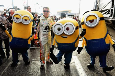 HOMESTEAD, FL - NOVEMBER 22: Jeff Gordon and the Minions at NASCAR Ford Championship Weekend in celebration of Minions on digital HD on November 24 and Blu-ray & DVD on December 8. (Photo by Gustavo Caballero/Getty Images For Universal Pictures Home Entertainment)