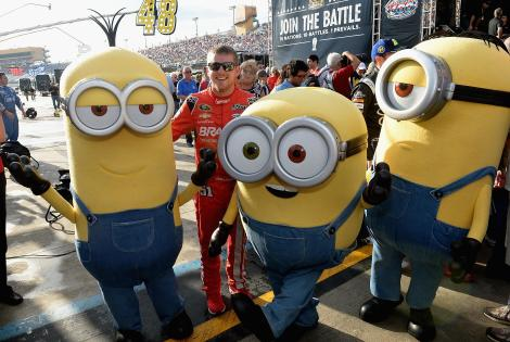 HOMESTEAD, FL - NOVEMBER 22: Justin Allgaier and the Minions at NASCAR Ford Championship Weekend in celebration of Minions on digital HD on November 24 and Blu-ray & DVD on December 8. (Photo by Gustavo Caballero/Getty Images For Universal Pictures Home Entertainment)