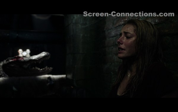 crawl blu-ray image, woman against wall, alligator mouth open in distance