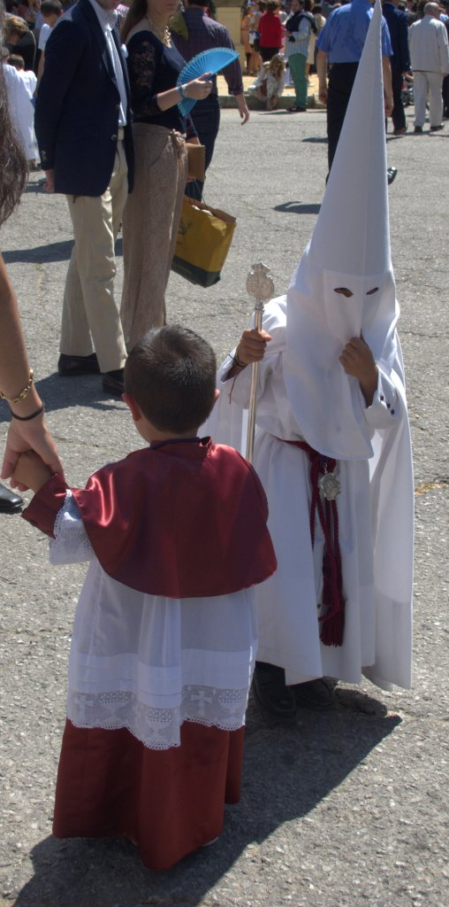 Nazarenos start young, and junior to them are monaguillos, or altar boys, who carry baskets of sweets to give out to children along the procession route.
