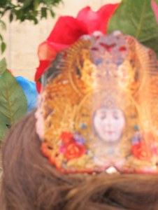 This shot is blurred, but you can see the face of the Virgen del Rocio on this lady's peineta (comb).