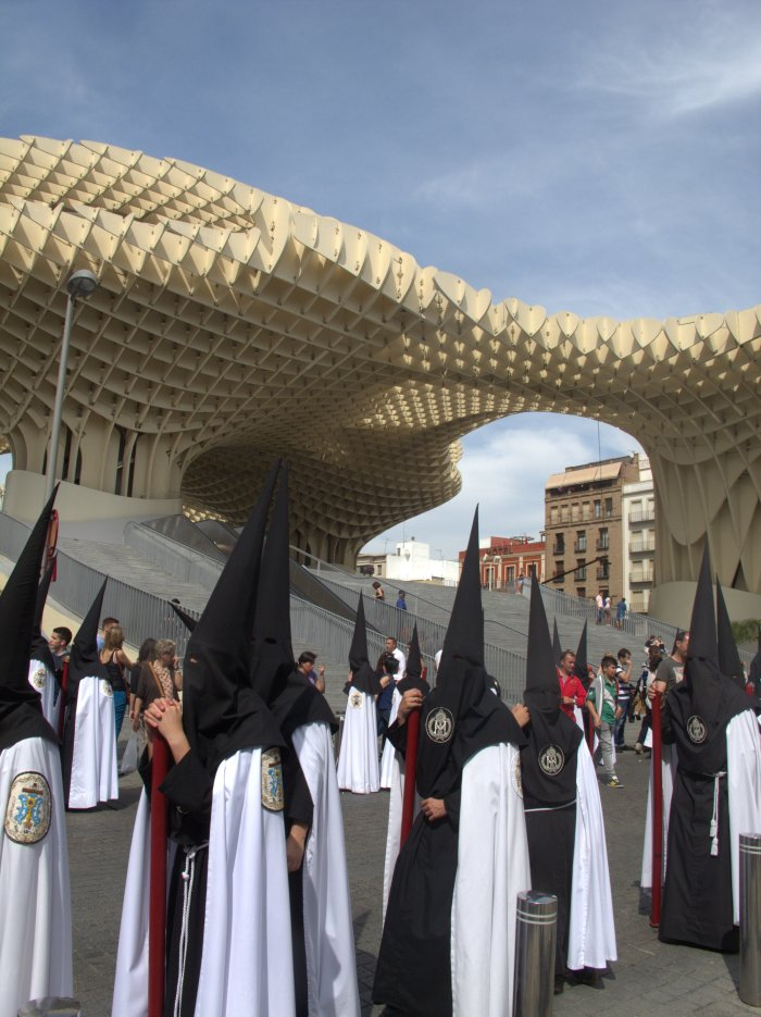 Age-old and contemporary Seville: a Holy Week procession passes the Setas.