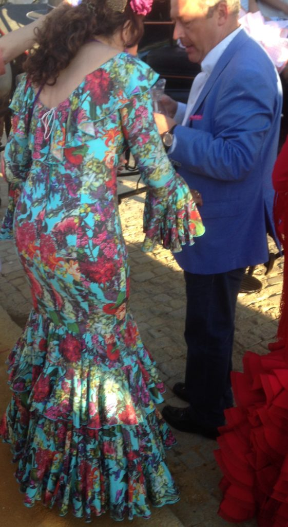 The great thing about flamenca dresses is that everyone looks good in them, especially if you've curvy.