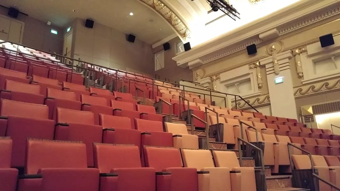 Dress and Upper Circle levels (Levels 3 and 4) of Capitol Theatre Singapore. With the flip-flip cinema seats.
