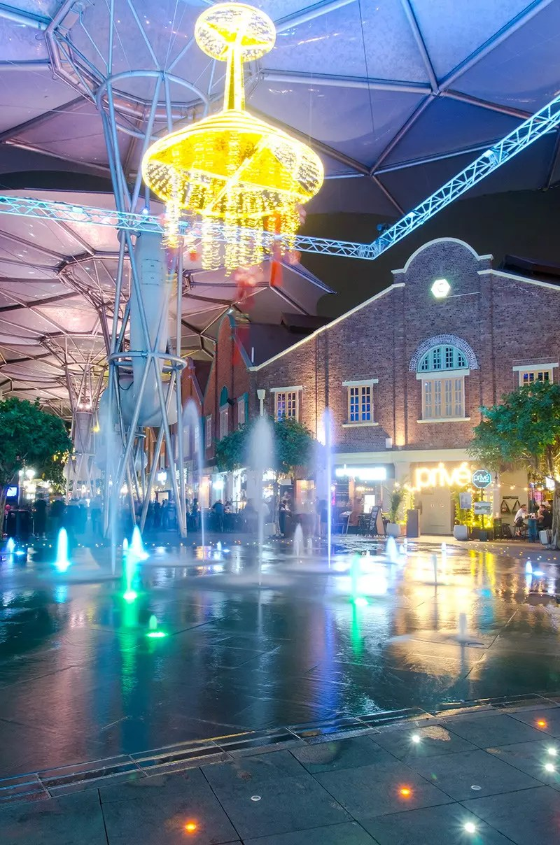 Singapore's Clarke Quay entertainment area at night. Clarke Quay used to be full of warehouses and godowns, till rejuvenated into an entertainment district in the 1990s.