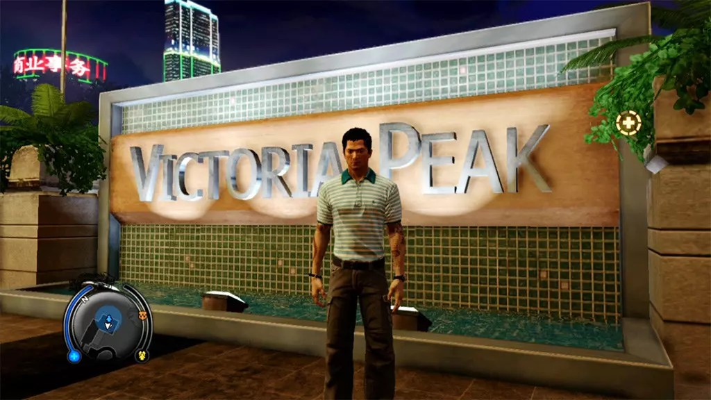 Wei Shen posing at Victoria Peak sign.