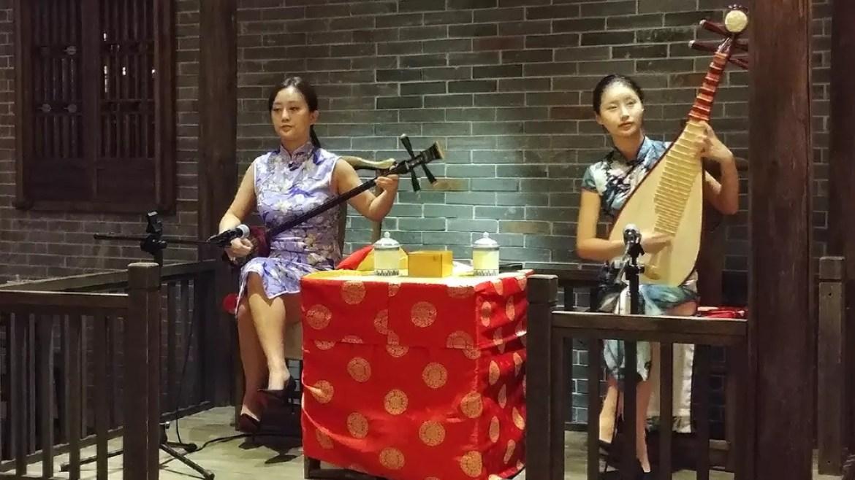 Suzhou ping tan music live performance at Nanjing Impressions Plaza Singapura outlet.