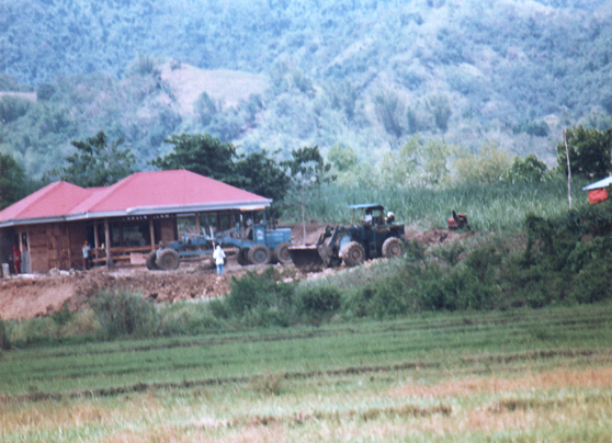 Heavy equipment are seen working at the house of Gov. Tupas in Brgy. Juanico, Banate, Iloilo sometime in April 2009
