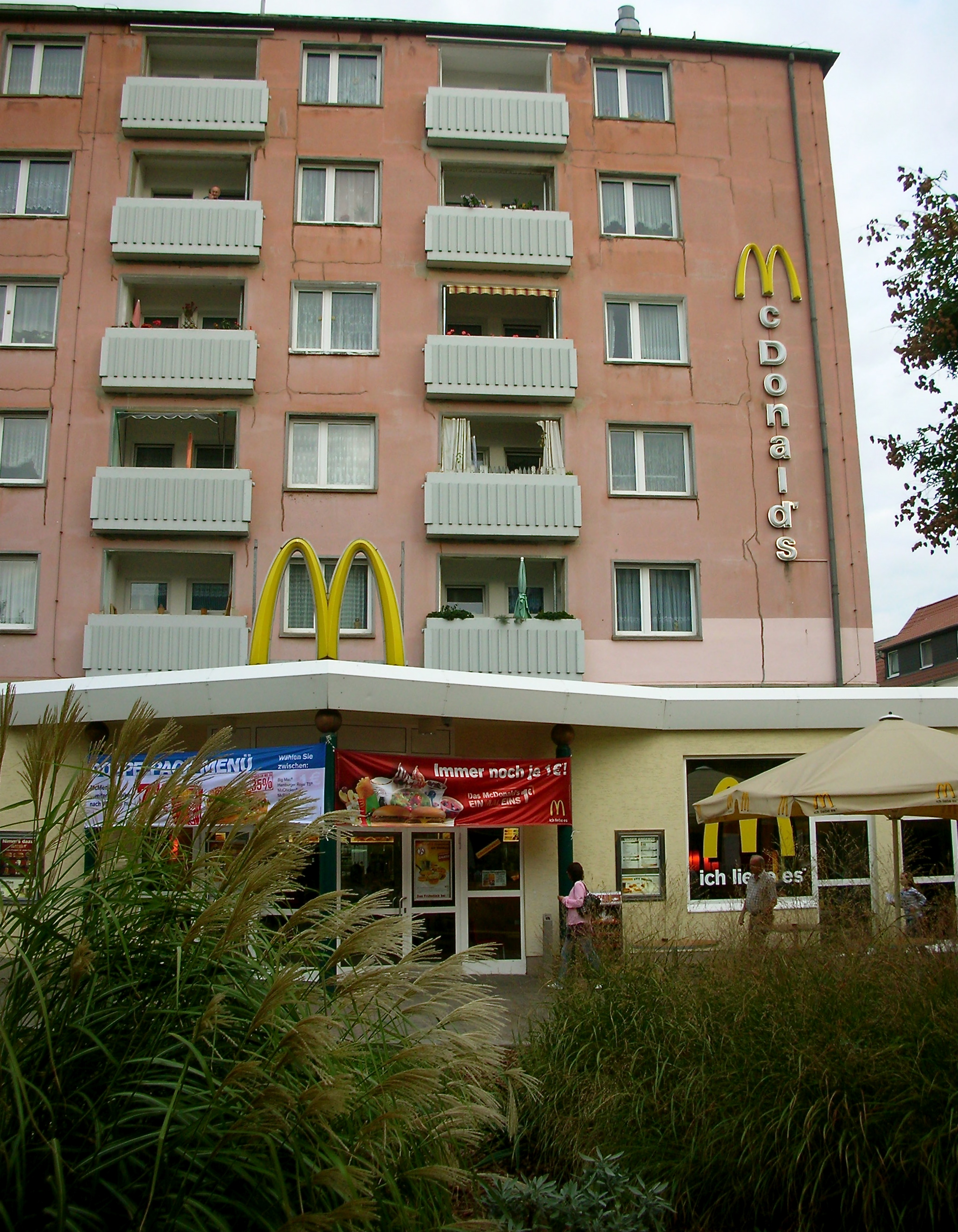 A McDonald's sign scales the wall of an apartment complex in Dessau