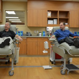 Father and son bond while giving blood